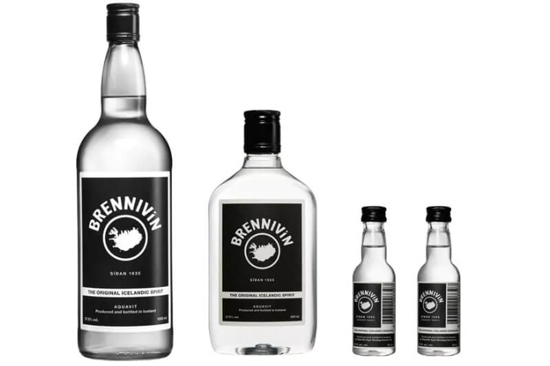 4 bottles of white spirit with black label on saying Brennivin