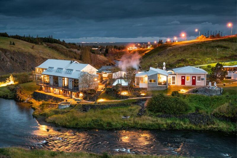 hotel on mountain landscape surounded by river in Iceland