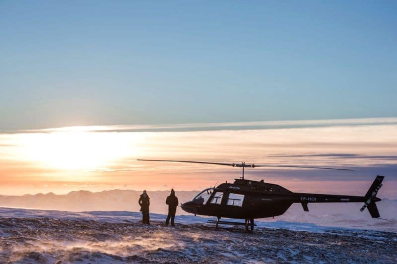 2 people on top of a mountain during an Iceland helicopter tour