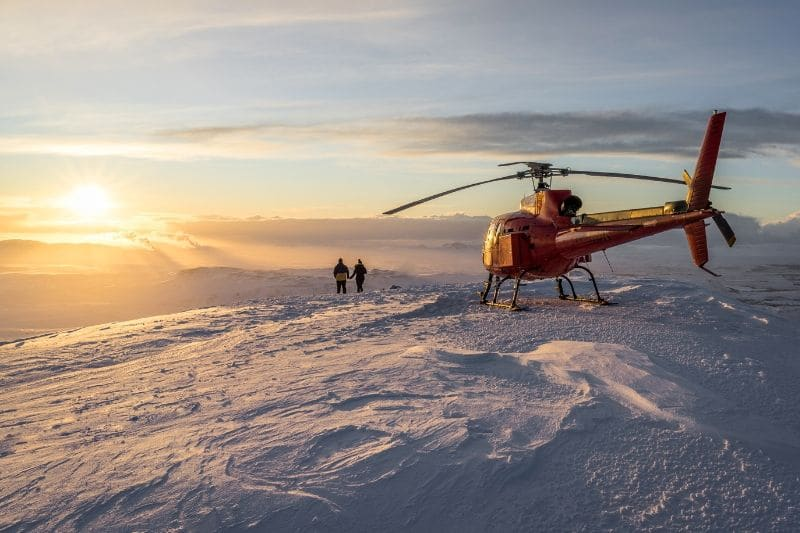 A helicopter on top of a mountain, a picture you can expect if you get a Iceland helicopter tours