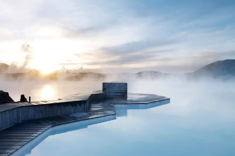 Steam rising from the azure water of the blue lagoon in Iceland