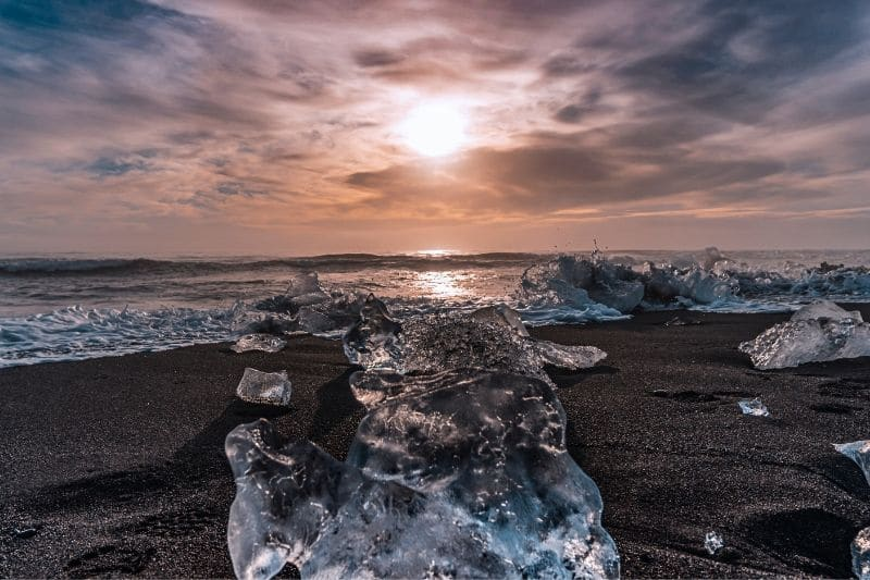 An Iceland winter tour is a great way to see the jet black sands and diamond beach