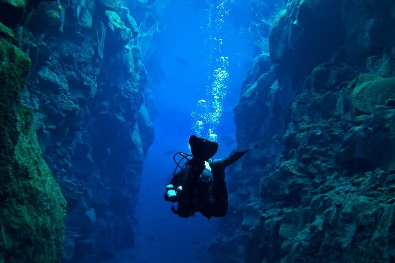 Diving in silfra fissure in Iceland during a tour