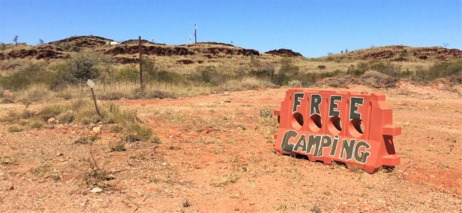 An orange block sign with the words 'free camping' in Australia