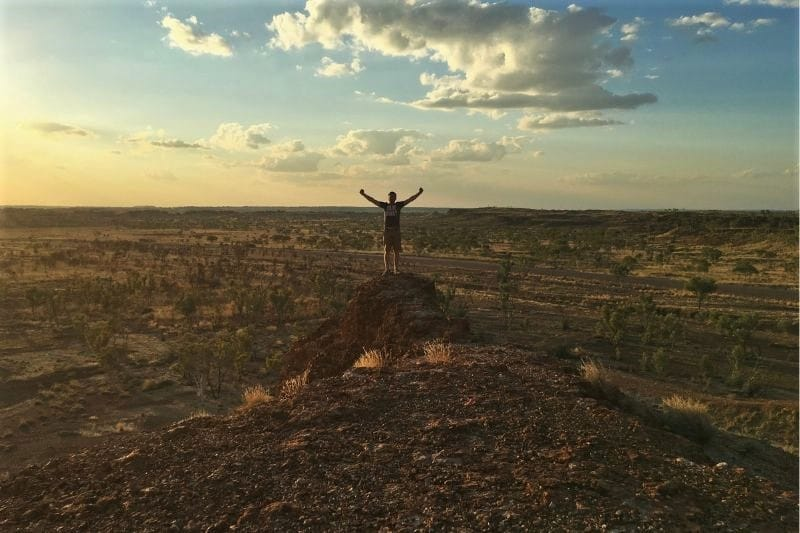 Man standing on ock in the outback