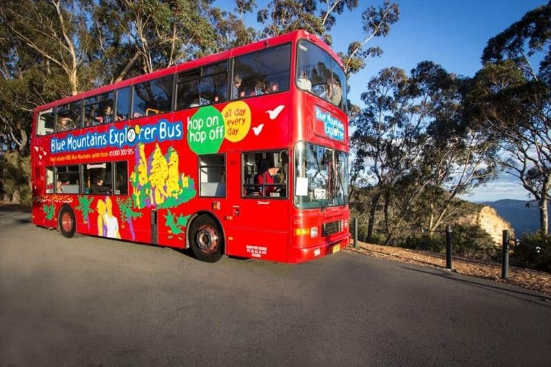 Double decker red tour bus with Blue Mountains Explorer Bus written on the side