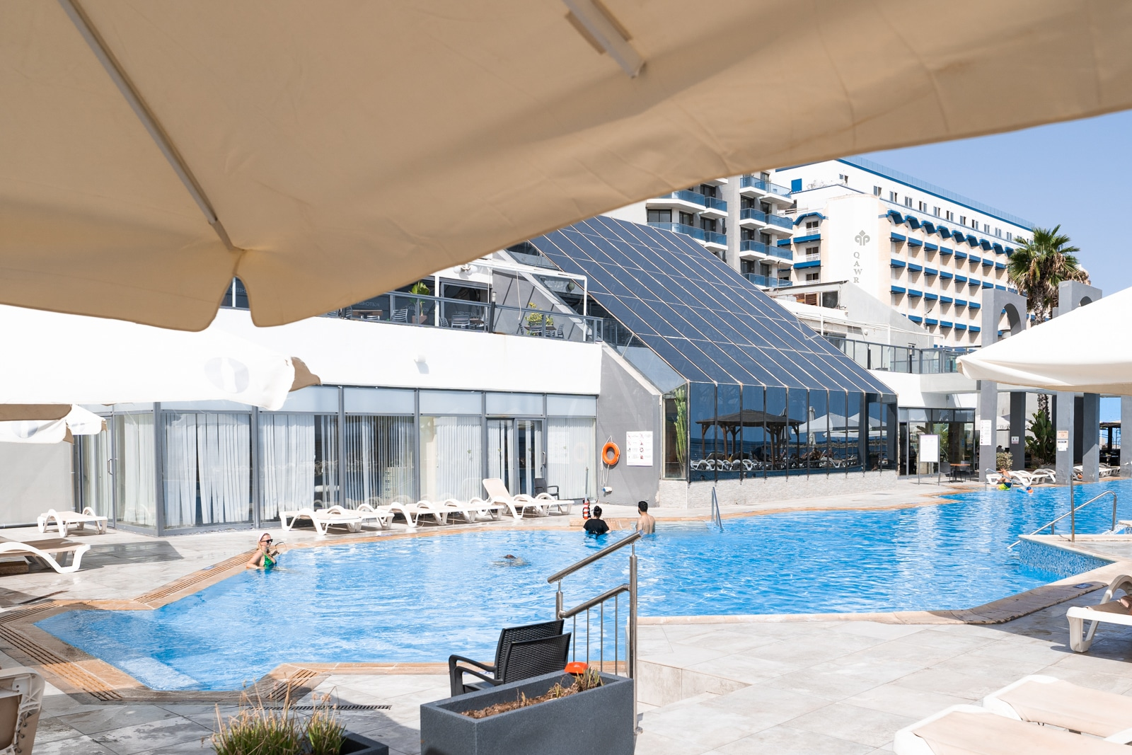 View from under umbrella of outdoor swimming pool