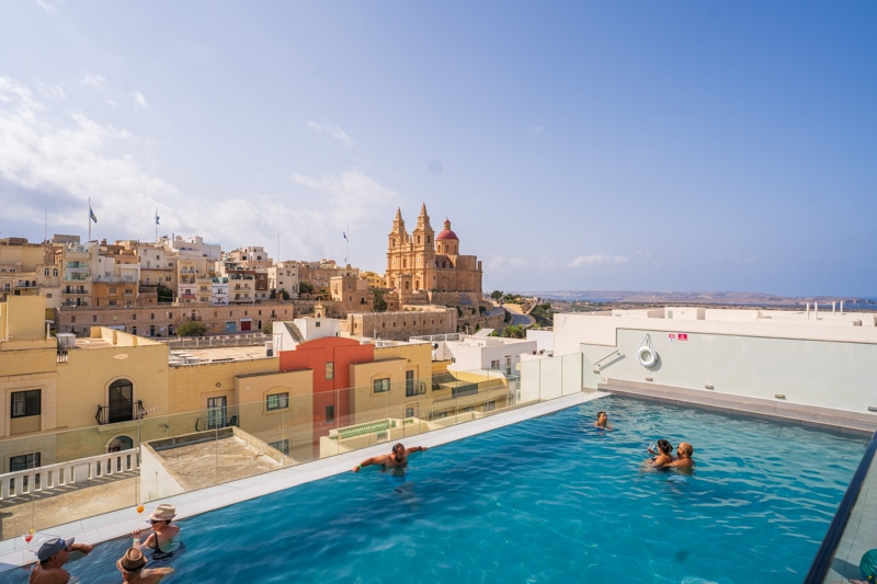 People relaxing in a rooftop infinity pool