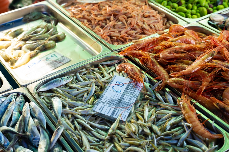 Fish and prawns being sold at market
