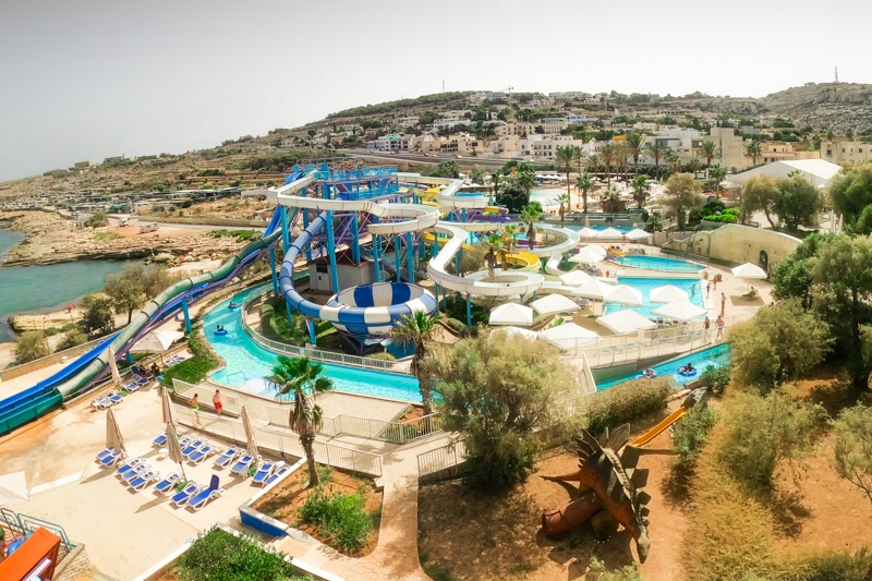 One of the best water parks in Malta with blue, white, yellow and purple twisty slides